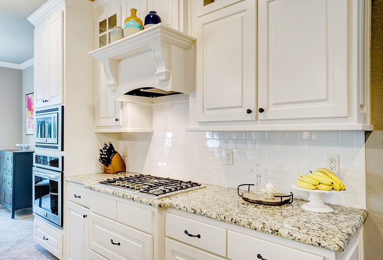 granite countertops and tile backsplash in Wayne